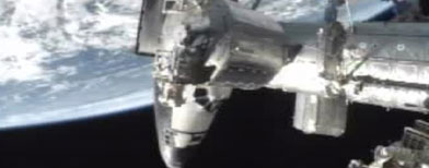 This frame grab from NASA-TV shows space shuttle Atlantis docked at the International Space Station, Sunday, July 10, 2011. Atlantis is delivering more than 4 tons of food, clothes and other space station provisions — an entire year's worth, in fact, to keep the complex going in the looming post-shuttle era. Atlantis' journey marks the final shuttle mission by NASA. (AP Photo/NASA)