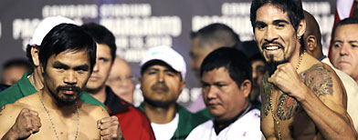 Manny Pacquiao, left,, and Antonio Margarito, (AP Photo/David J. Phillip)