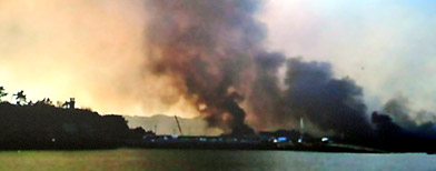 Smoke billow from Yeonpyeong island near the border against North Korea. (AP Photo/Yonhap)