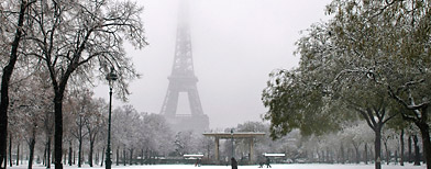 A men walks near the Eiffel Tower after snow fell on the French capital, Wednesday, Dec. 8, 2010. (Jacques Brinon/AP Photo)