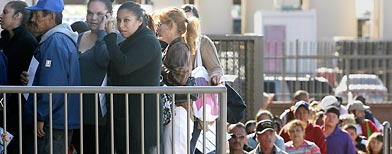 Hundreds lined up at the St. Mary's Food Bank Alliance Monday, Nov. 22, 2010, in Phoenix. (AP/Ross D. Franklin)