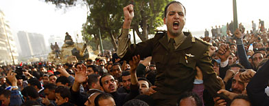 An army officer who joined anti-government protester chants slogans, in downtown Cairo, Egypt, Saturday, Jan. 29, 2011 (AP Photo/Khalil Hamra)