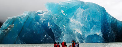A group of people travel with Glacier Explorers to see one of the many icebergs that caved into Tasman Lake. (AP/NZPA, Denis Callesen)