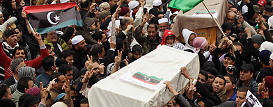Mourners carry coffins containing the bodies of Libyans who were killed in the recent clashes in Benghazi February 25, 2011. (Suhaib Salem/Reuters)