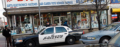 Police in a downtown shopping area in Camden, N.J., on Nov. 17, 2010, before large layoffs hit the department. (Mel Evans/AP Photo)