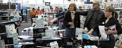 A shopper points to the item he's looking for while shopping at an electronics store in Albuquerque, N.M., on Friday, Nov. 26, 2010. Shoppers around New Mexico hit the stores early to take advantage of Black Friday sales. (AP Photo/Susan Montoya Bryan)