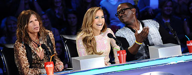 (L-R) Judges Steven Tyler, Jennifer Lopez and Randy Jackson at the American Idol Season 10 Top 11 live performance show, March 23, 2011 in Los Angeles, California. (Photo by Michael Becker/Fox/PictureGroup)