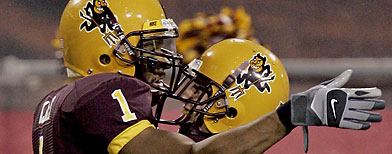 ARCHIVE: Arizona State wide receiver Michael Jones (1) celebrates his touchdown with teammate Chris McGaha during the third quarter of a football game Saturday, Sept. 22, 2007 at Sun Devil Stadium in Tempe, Ariz. (AP Photo/Matt York)