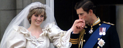 Prince Charles kisses the hand of his new bride, Princess Diana on the balcony of Buckingham Palace on their wedding day.  (Photo by Tim Graham/Getty Images)
