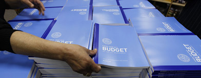 Copies of the U.S. Government budget for Fiscal Year 2012 are stacked up at the U.S. Government Printing Office in Washington, Monday, Feb. 14, 2011.(AP Photo/Alex Brandon)