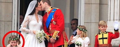 Prince William kisses his wife Kate, Duchess of Cambridge on the balcony of Buckingham Palace. (AP Photo/Matt Dunham)