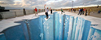 "Spectators ""fall"" into a sidewalk crevasse. (Photo copyright Edgar Mueller/metanamorph.com)"