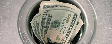 Money down drain (Thinkstock)
