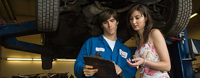Mechanic and customer in garage (Thinkstock)