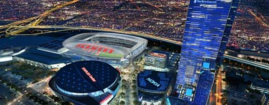 In an image provided by AEG, a proposed NFL football stadium, to be named Farmers Field, is depicted next to Staples Center in Los Angeles. (AP Photo/AEG)
