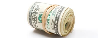 Roll of cash (Corbis)