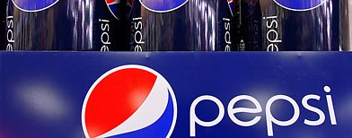 Bottles of Pepsi are dispalyed at a grocery store in Springfield, Ill., Wednesday, Feb. 9, 2011. PepsiCo Inc. said Thursday Feb. 10, its fourth-quarter net income fell 5 percent despite a surge in revenue as it faced higher costs.( AP Photo/Seth Perlman)