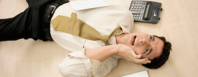 Businessman with headache (Thinkstock)