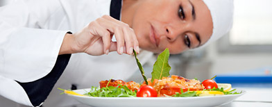 Chef decorating plate of food (Thinkstock)