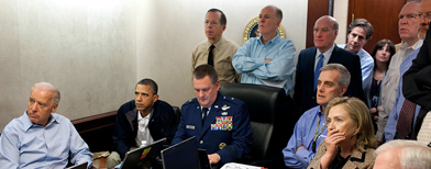 Secretary of State Hillary Rodham Clinton, President Barack Obama and Vice President Joe Biden, along with with members of the national security team, receive an update on the mission against Osama bin Laden in the Situation Room of the White House in Washington. Hidden from view, standing just outside the frame of this photograph was a career CIA analyst whose job for nearly a decade was finding the al-Qaida leader. (The White House, Pete Souza/file/AP Photo)