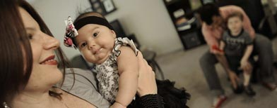 Gina Crosley-Corcoran holds her two-month-old daughter, Jolene. (AP Photo/Paul Beaty)