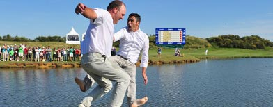 Thomas Levet of France and his manager Patrice Bartez, jump into the lake on the 18th hole after winning The Open de France presented by Alstom at the Golf National Golf Club on July 3, 2011 in Paris, France. (Photo by Stuart Franklin/Getty Images)