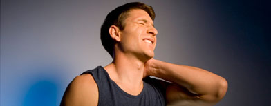 Man rubbing sore neck. (Creatas Images)