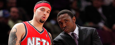 New Jersey Nets head coach Avery Johnson (right) talks with guard Deron Williams. William Perlman/The Star-Ledger via US PRESSWIRE
