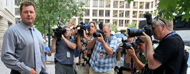 Baseball pitching star Roger Clemens is surrounded by news photographers as he waits for his ride after leaving the U.S. District Court on the first day of his trial, on July 6, 2010 in Washington, DC. Seven-time Cy Young Award winner Clemens attended the first day of his trial for making false statements, perjury and obstructing Congress when he testified in a February 2008 inquiry by the House Oversight and Government Affairs. (Photo by Mark Wilson/Getty Images)
