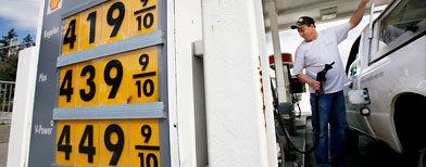 Ryan Riemath finishes filling his tank at a Shell gas station Tuesday, April 26, 2011, in the Seattle suburb of Bellevue, Wash. (AP)