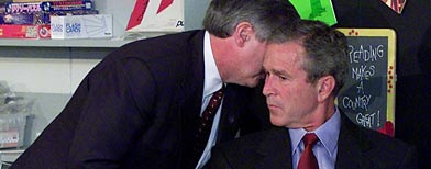 In this Sept. 11, 2001 file photo, President Bush's Chief of Staff Andy Card whispers into the ear of the President to give him word of the plane crashes into the World Trade Center, during a visit to the Emma E. Booker Elementary School in Sarasota, Fla.