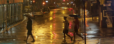 Hurricane Irene batters New York | People cross the street in lower Manhattan amid rain caused by the approaching storm. (AP Photo/Mary Altaffer)