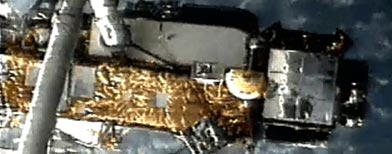 This screen grab image provided by NASA shows UARS attached to the robotic arm of the space shuttle Discovery during mission STS-48 in 1991. (AP/NASA file photo)