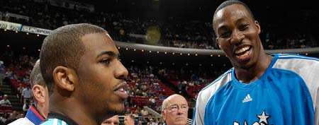 Dwight Howard #12 of the Orlando Magic and Chris Paul #3 of the New Orleans Hornets greet each other before a game (Photo by Fernando Medina/NBAE via Getty Images)