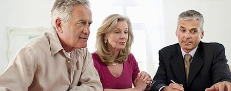 Financial planner advising couple (Corbis)