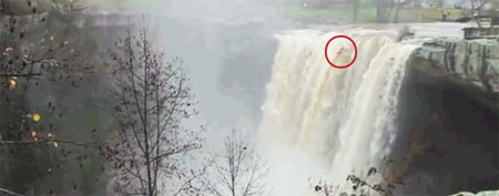 A kayaker is nearly lost in the foam of a waterfall near Gadsden, Ala. (Y! Sports screengrab)