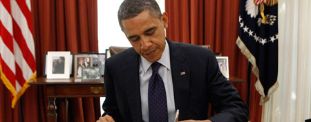 President Obama signs bill (Reuters)