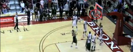 Wagner's Kenneth Ortiz throws in a shot from behind the backboard at the buzzer (Y! Sports screengrab)