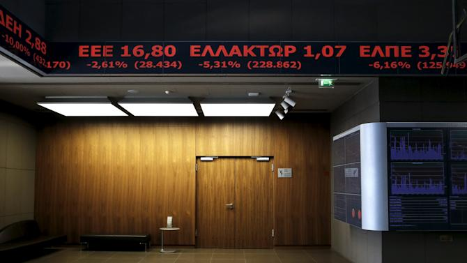 A stock ticker shows stock options making losses at the lobby of the Athens stock exchange building