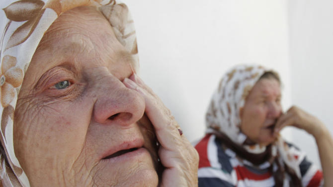 Bosnian Muslims Hasiba Ahmic, 72,left, and  Naza Hasanovic,68, sit in front of their shelter at the collective center for refugees near the northern Bosnian town of Zivinice, 130 kms north of Sarajevo, Monday, June 20, 2011, where they settled after being displaced from their homes in eastern Bosnia in 1995. Many refugees and internal displaced persons war still live in primitive shelters waiting to return to their destroyed pre-war homes, 16 years after the 1992-95 Bosnian war. On World Refugee Day, which is marked in Bosnia today, a total of 43.7 million displaced people have been registered in the world, 15.4 million of whom are refugees.(AP Photo/Amel Emric)