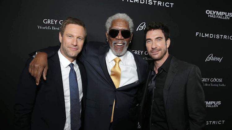 Aaron Eckhart, Morgan Freeman and Dylan McDermott at FilmDistrict's Premiere of 'Olympus Has Fallen' hosted by Brioni and Grey Goose at the ArcLight Hollywood, on Monday, March, 18, 2013 in Los Angeles. (Photo by Eric Charbonneau/Invision for FilmDistrict/AP Images)