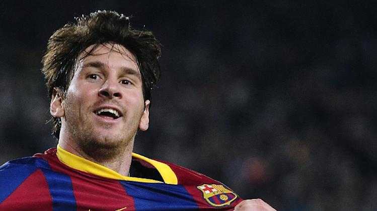 In this April 9, 2011 file photo,  FC Barcelona's Lionel Messi from Argentina, celebrates after scoring during his Spanish La Liga soccer match against Almeria at the Camp Nou stadium in Barcelona, Spain. On Friday, Dec. 20, Messi criticized a Barcelona vice president who said he doesn't deserve a better contract