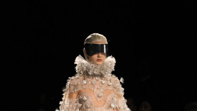 A model wears a creation by British designer Sarah Burton for Alexander McQueen as part of the Fall-Winter, ready-to-wear 2013 fashion collection, during Paris Fashion week, Tuesday, March 6, 2012. (AP Photo/Christophe Ena)