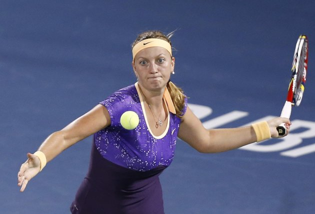 Kvitova of the Czech Republic hits a return to Radwanska of Poland during their women's singles quarter-final match at the WTA Dubai Tennis Championships