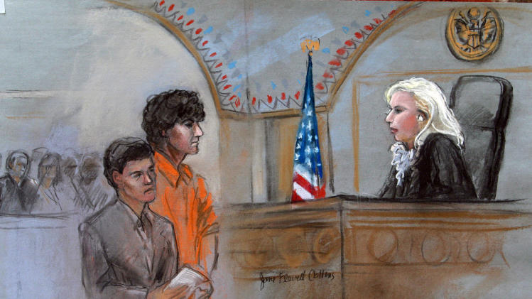 This courtroom sketch depicts Boston Marathon bombing suspect Dzhokhar Tsarnaev standing with his lawyer Judy Clarke, left, before Magistrate Judge Marianne Bowler, right, during his arraignment in federal court Wednesday, July 10, 2013 in Boston. The 19-year-old has been charged with using a weapon of mass destruction, and could face the death penalty. (AP Photo/Jane Flavell Collins)