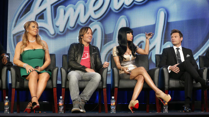 """Mariah Carey, Keith Urban, Nicki Minaj and Ryan Seacrest from """"American Idol"""" attend the Fox Winter TCA Tour at the Langham Huntington Hotel on Tuesday, Jan. 8, 2013, in Pasadena, Calif. (Photo by Todd Williamson/Invision/AP)"""