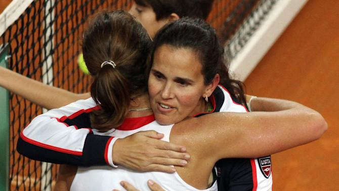 United States' Varvara Lepchenko, back to camera, celebrates with her team captain Marie Joe Fernandez after defeating Italy's Roberta Vinci during a World Group first round Fed Cup tennis match at the 105 stadium in Rimini, Saturday, Feb. 9, 2013. Lepchenko won 2-6, 6-4, 7-5. (AP Photo/Felice Calabro')