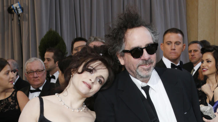 Actress Helena Bonham Carter, left, and director Tim Burton arrive at the Oscars at the Dolby Theatre on Sunday Feb. 24, 2013, in Los Angeles. (Photo by Todd Williamson/Invision/AP)