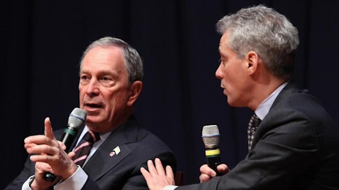 "New York City Mayor Michael Bloomberg, left, and Chicago Mayor Rahm Emanuel, take part in a forum on education at American University in Washington, Friday, March 2, 2012. Bloomberg uses his radio show to respond to New Jersey officials' criticism of the New York Police Department's surveillance of Muslims, saying it is a ""bit ridiculous"" to suggest the NYPD shouldn't cross the same state line that Sept. 11 terrorists did. (AP Photo/Jacquelyn Martin)"