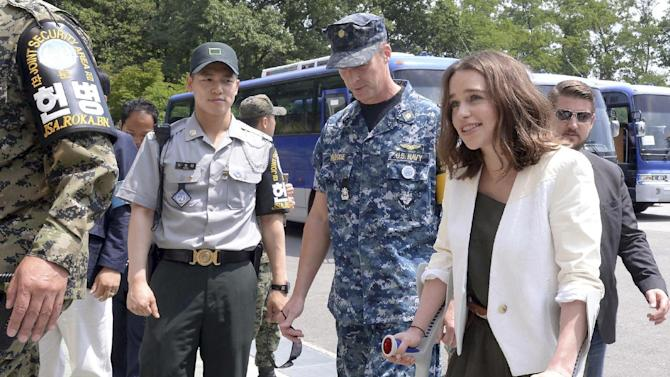 "Actress Emilia Clarke arrives to enter a meeting room of the Military Armistice Committee during her visit to the border village of Panmunjom in Paju, South Korea, Friday, July 3, 2015. Clarke is in South Korea to promote her new film ""Terminator Genisys."" (Kwon Ho-wook/The Kyunghyang Shinmun via AP) KOREA OUT"